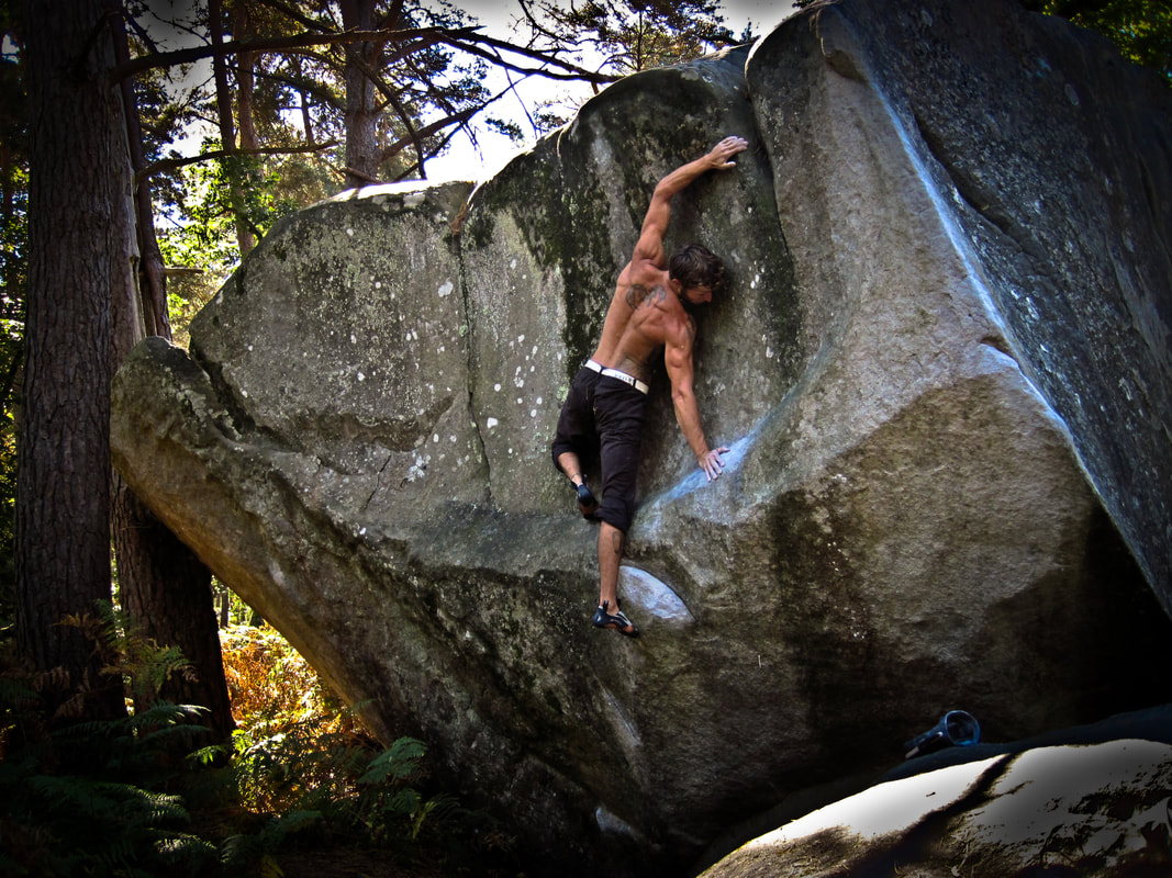 Sam Hunter throwing shapes on the 'Atmosphère' boulder in the Forest of Fontainebleau