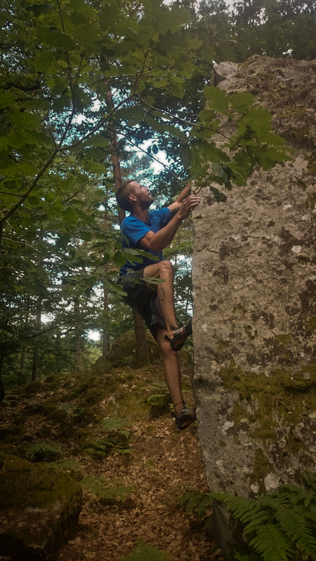 Sam climbing a gem of an angle in the Cosmos sector of Mont Aigu, Fontainebleau