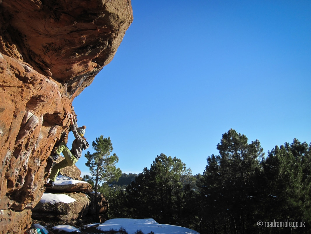 Amber climbing in the cold at sector Arrastradero in Albarracin, Spain.