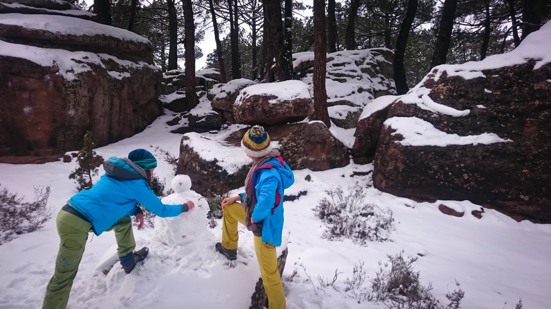 Amber and Frances building a snow man in the Parking sector at Albarracin
