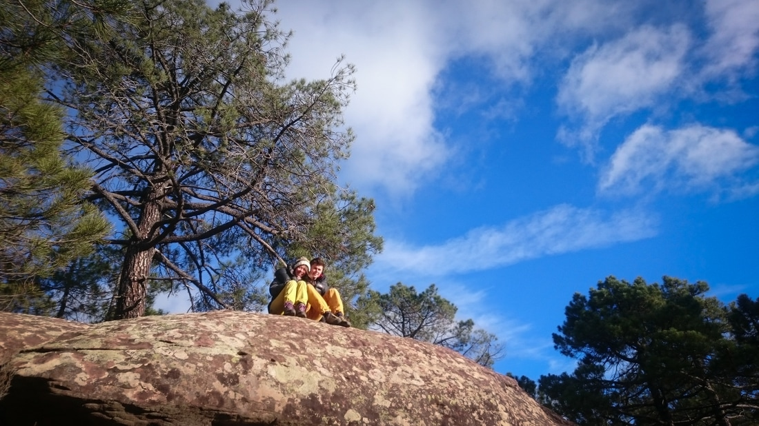 Frances and Will posing on a boulder in Albarracin