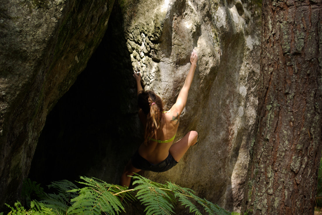 Amber Thornton climbing 'Supersymétrie' (7a+), a hidden gem of a boulder in Fontainebleau