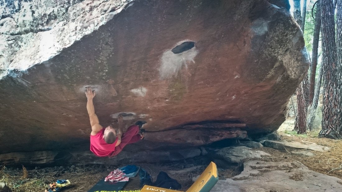 Sam sticking the first hard move on Cosmos (8a) at sector Techos, Albarracin.