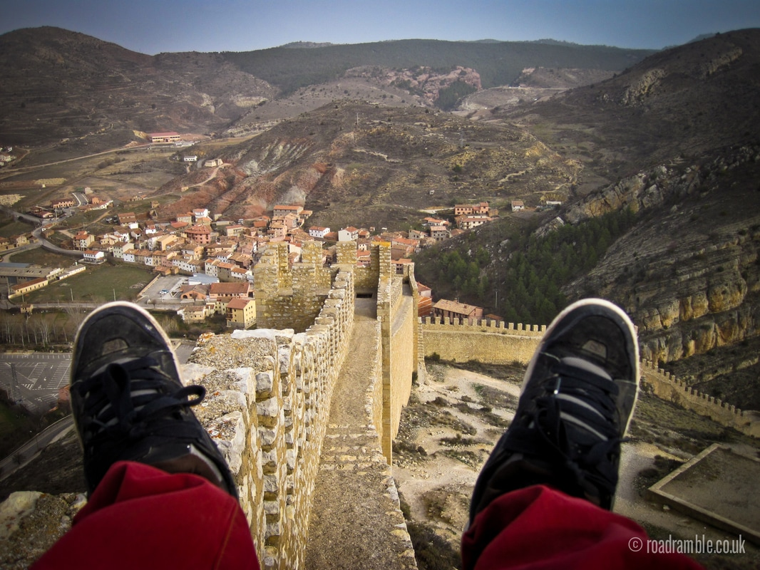 Dangling feet from the wall above Albarracin, Spain