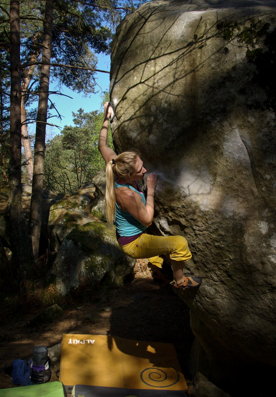 Anika lining up the moves on Double Axel (7a+) at Cassepot Roches Grises, Fontainebleau