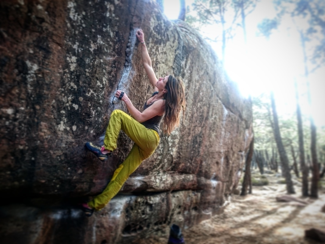 Amber Thornton climbing Emportration (7a) at sector Parking in Albarracin, Spain.