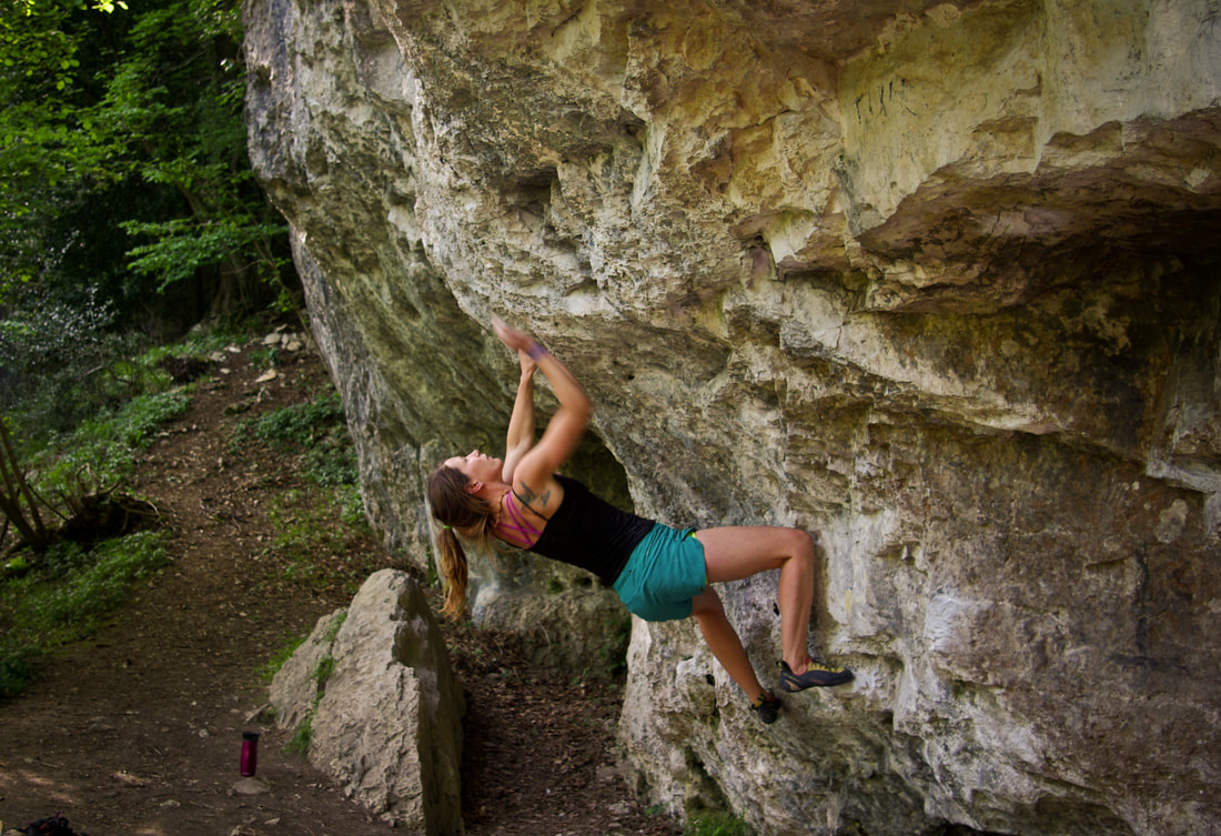 Amber giving Pop for the Top (7A) a go at Biblin's Cave