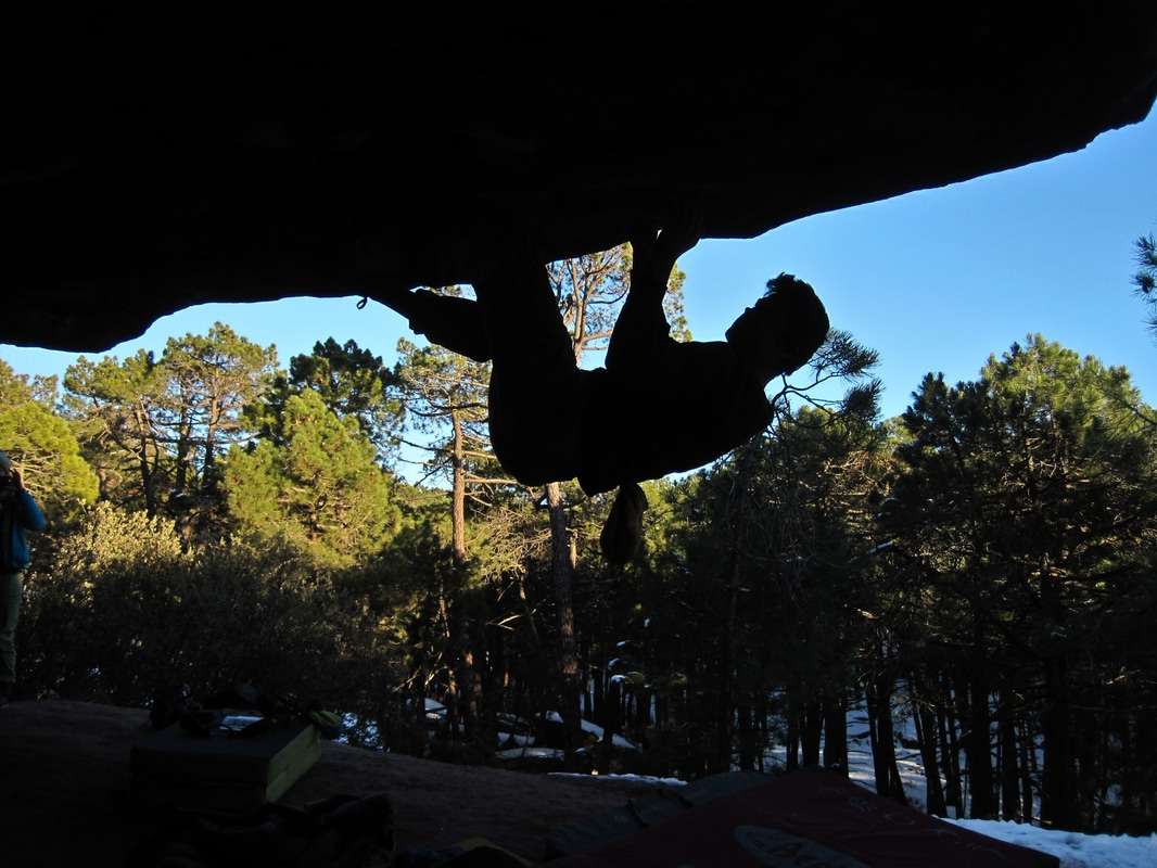 Will Smith beasting through one of the many roof boulders at Albarracin