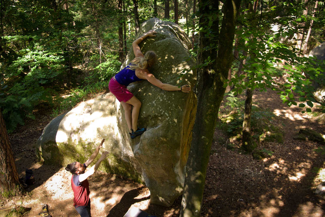 Nico spotting Anika off a beautiful prow boulder at Mont Ussy, Fontainebleau