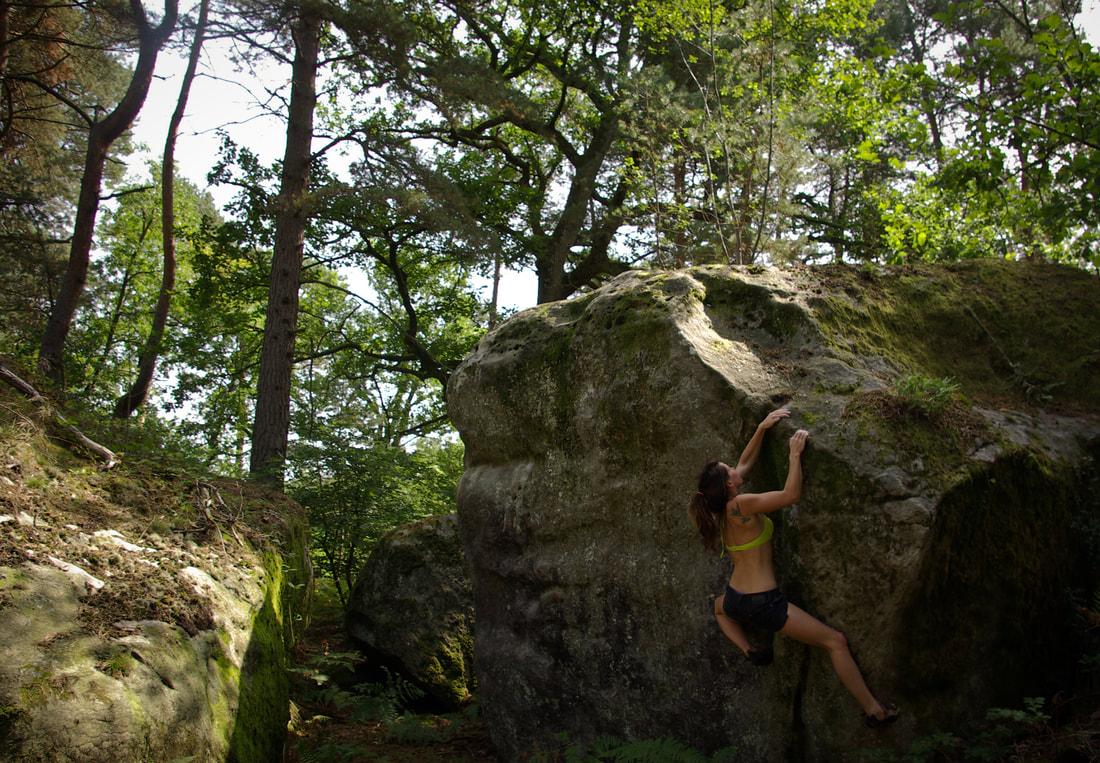 Amber Thornton climbing another lovely arete at Mont Aigu in Fontainebleau forest