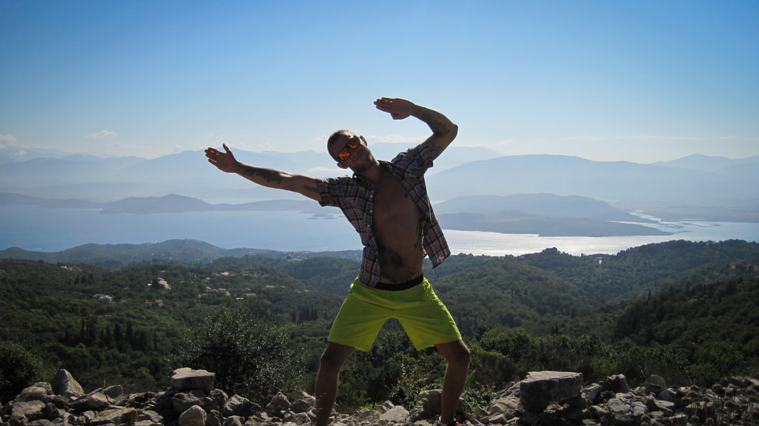 Sam Hunter striking a pose on the hike to the highest point on Corfu.