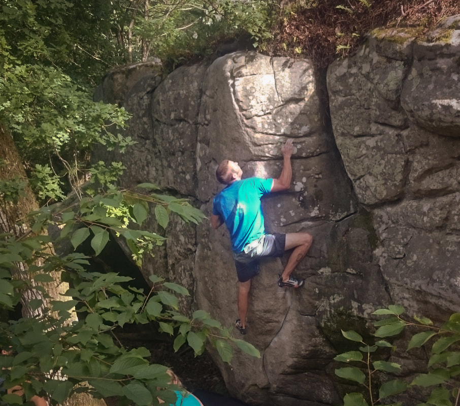 climbing the beautiful boulders of Rocher Gréau in Nemours, south of Fontainebleau