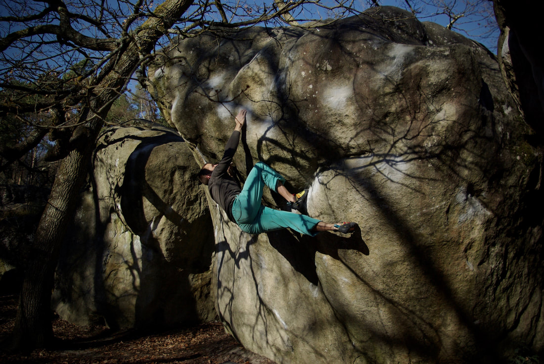 Sam Hunter climbing La Bérézina, the first 7c in the Forest of Fontainebleau at Cuvier