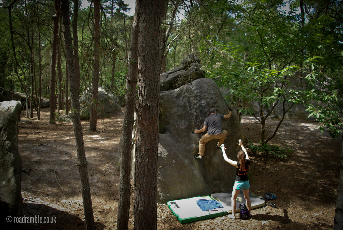 Peter moving elegantly up a classic Roche aux Sabots blue circuit problem in the forest of Fontainebleau