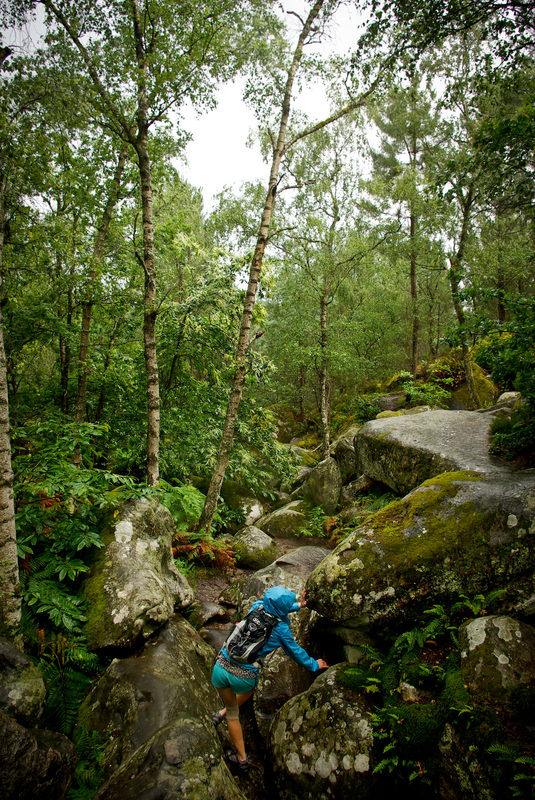 Navigating the wet boulders in the Trois Pignons forest