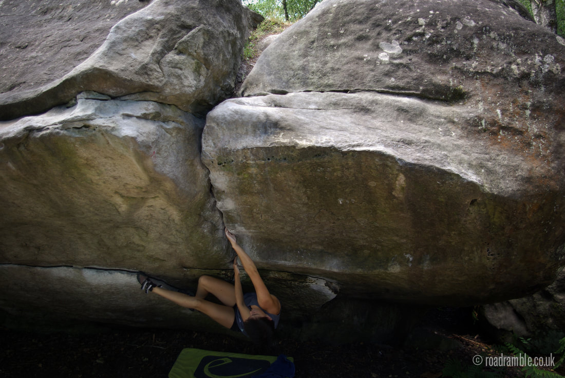 Amelia 'Mel' Gross working Le Grande Marche (7a+) at Canche aux Merciers in Fontainebleau