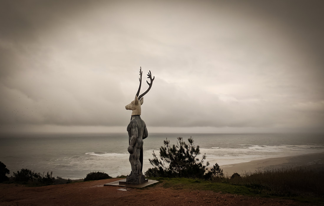 Monument of the Stag by the headland lighthouse at the Praia do Norte, Nazare, Portugal