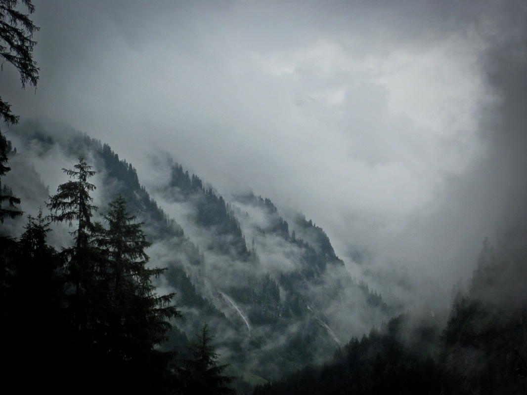 clouds sinking into a mountainous valley in Austria
