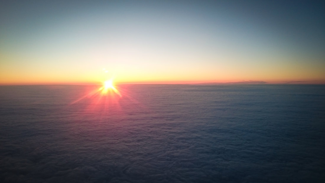 Sunset over the cloud horizon from the aeroplane