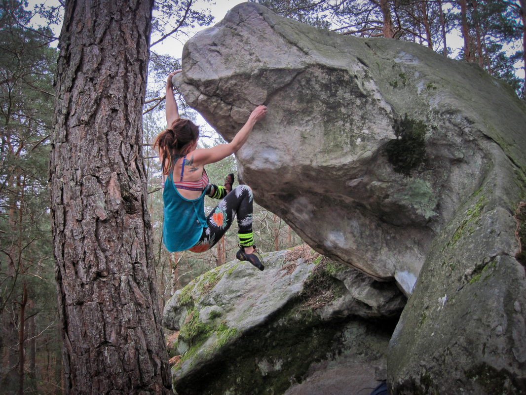 Bouldering Nezzo (6b+) in Fontainebleau.