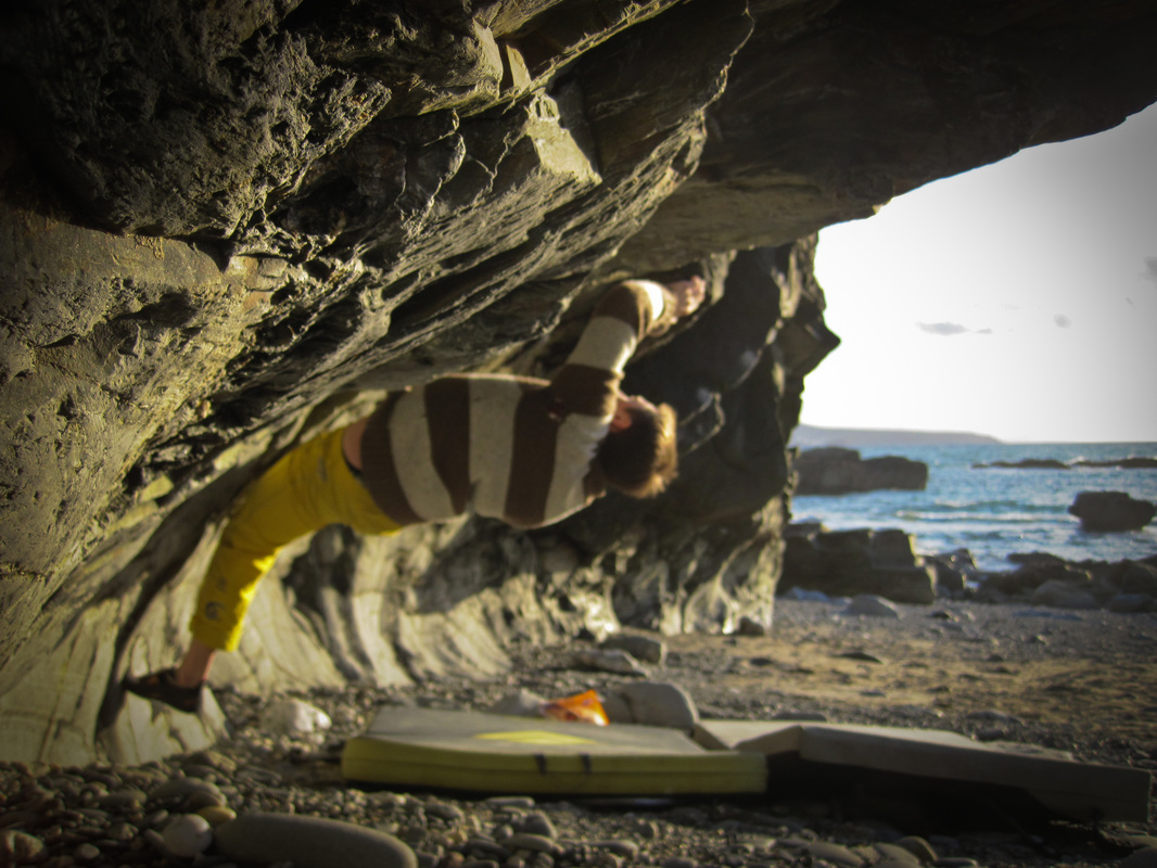 Leigh attempting Virginia (7a) in the evening sun at Godrevy.