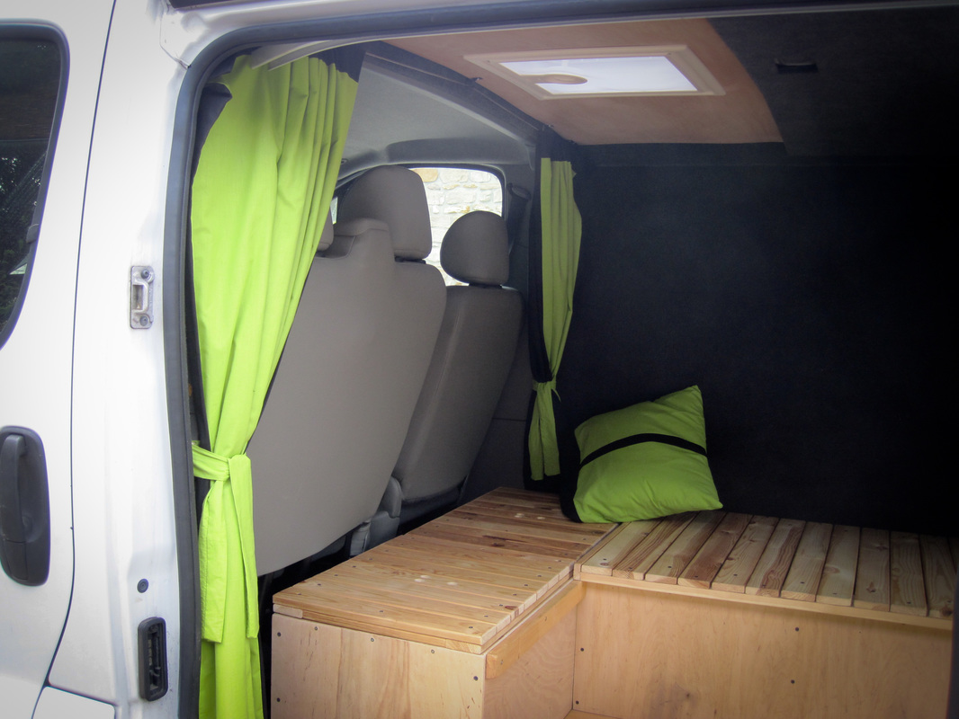 Curtains and cushion to make the van feel more homely