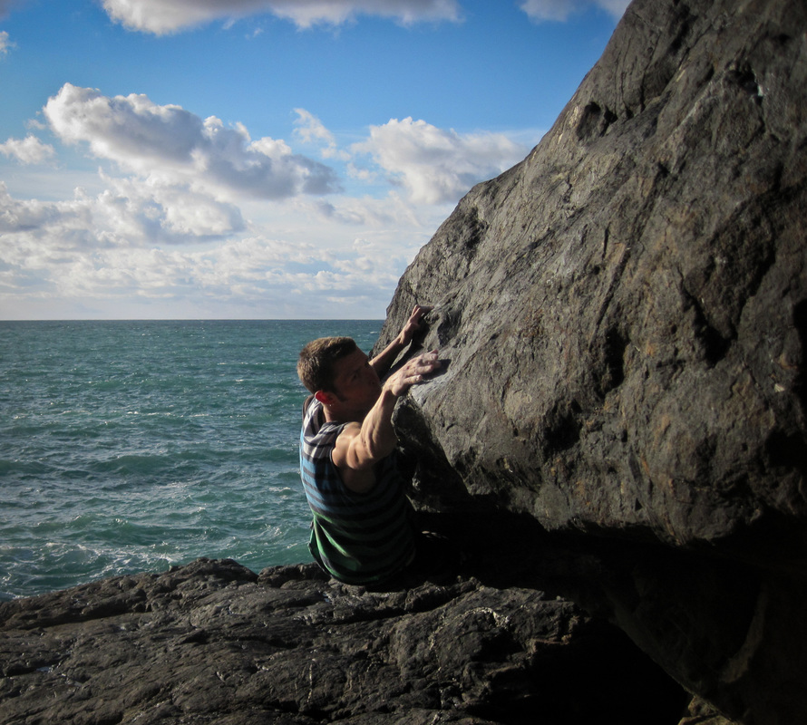 Sam attempting Psycho Cowboy (7c+), Pentire Point.