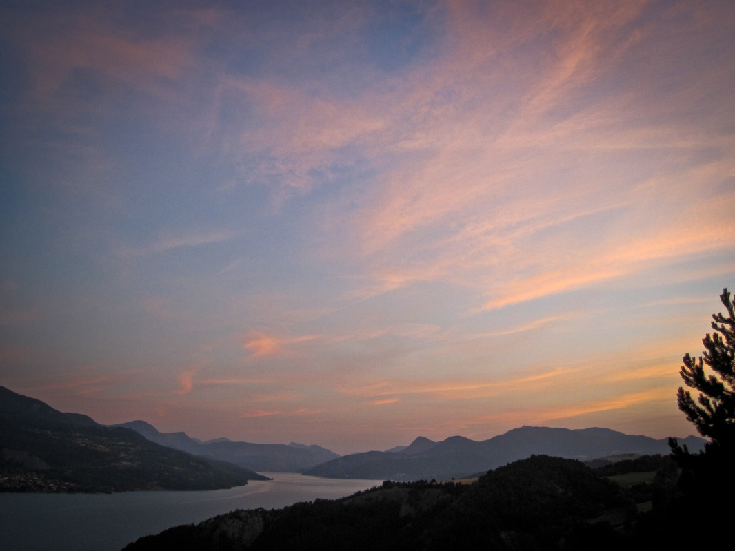 photograph of the sunset remains over the lac du serre poncon