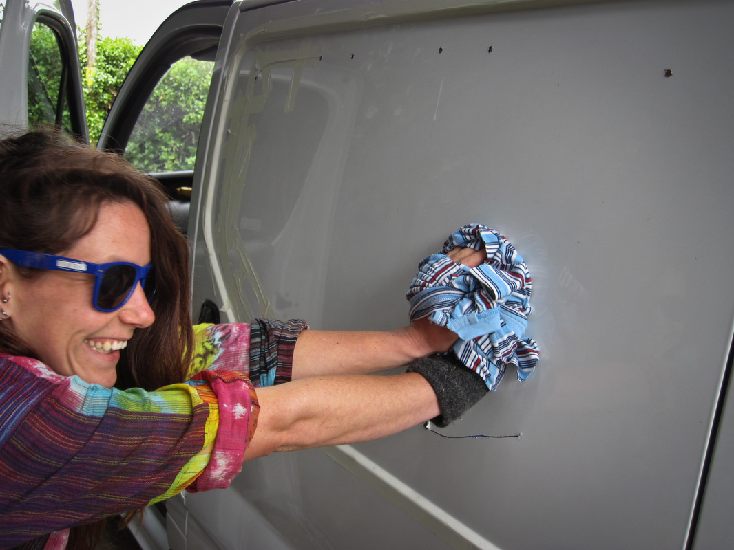 Cutting a hole in the side of the van for a window