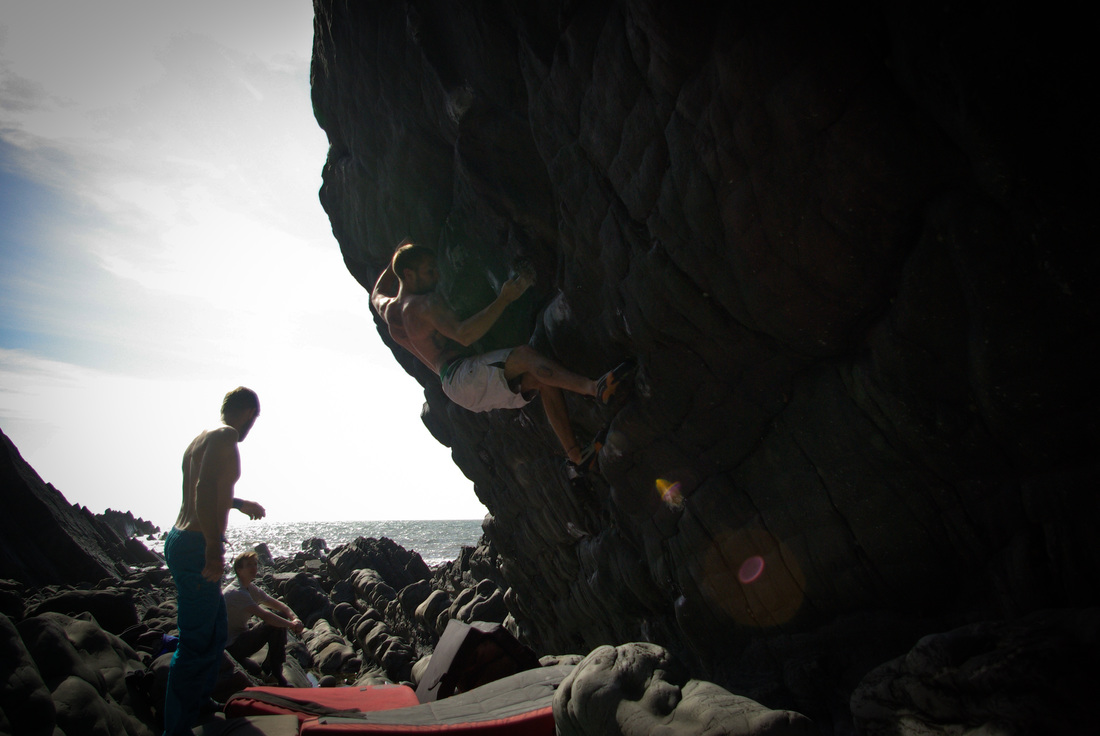 Sam working through Corridors of Power (7c) at Hartland Quay.