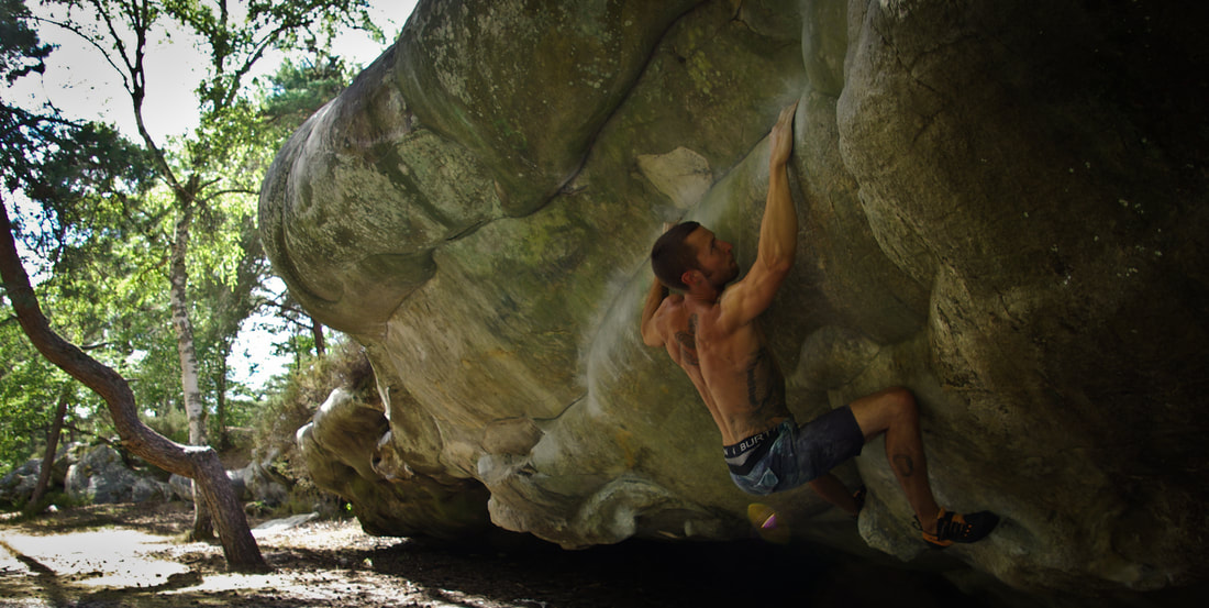 Sam Hunter working Atomic Playboy Raccourci (7c+) at Buthiers Piscine in the summer heat.