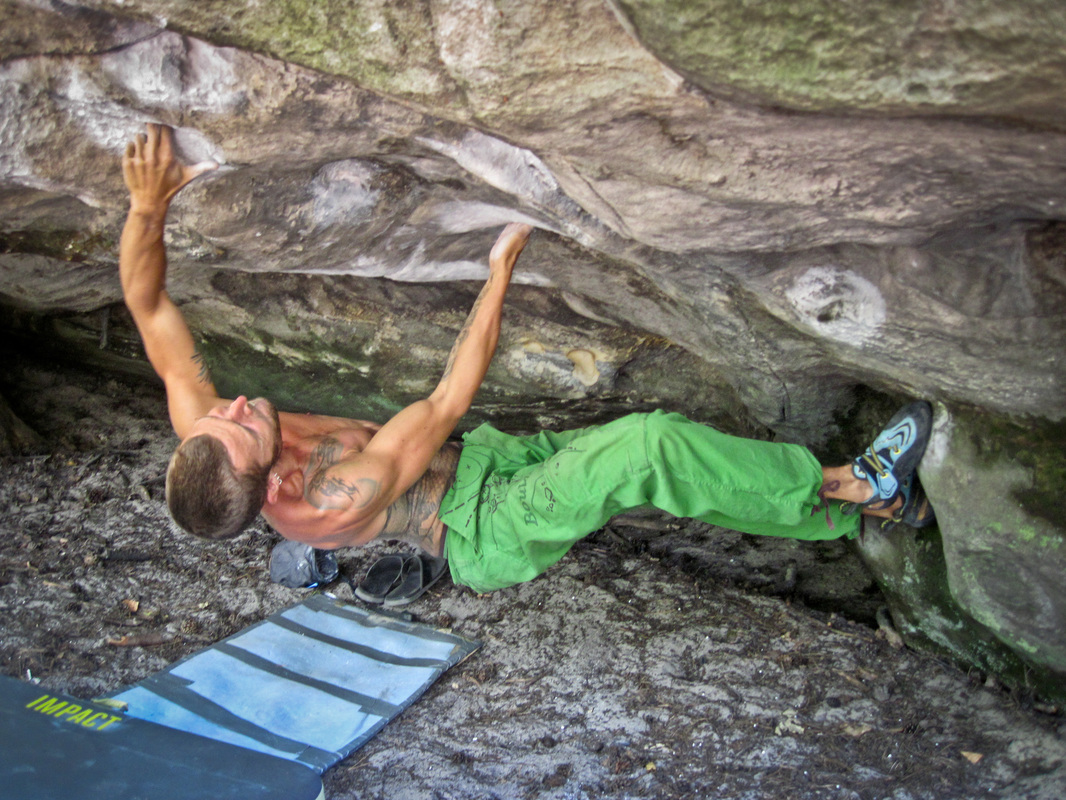 Sam powering through Magic Bus, 7b+ at Buthiers, Fontainebleau bouldering