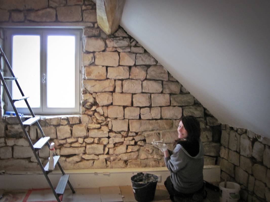 Pointing an interior stone wall