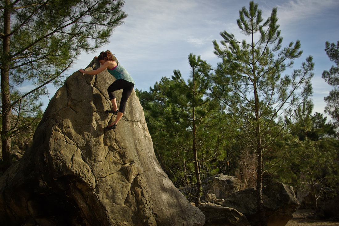 Amber Thornton bouldering in Fontainebleau